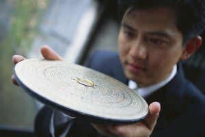 Businessman with Feng Shui Compass